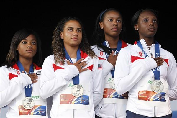 The USA women's 4x100m team on top of the podium, after setting a world junior leading time of 43.44 (Getty Images)