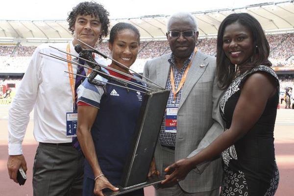 Shaun Campbell, Rachel Yankey, Lamine Diack and Dentaa Amoateng pose with Arthur Wharton Trophy at London's Olympic stadium, Saturday 27 July 2013 (Arthur Wharton Foundation)