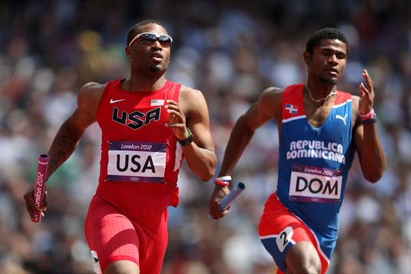 Manteo Mitchell of the United States and Gustavo Cuesta of Dominican Republic compete during the Men's 4 x 400m Relay Round 1 heats on Day 13 of the London 2012 Olympic Games  on August 9, 2012 (Getty Images)