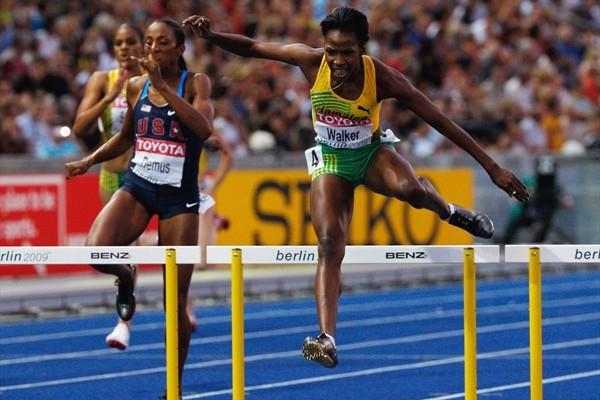 Lashinda Demus of the United States and Melaine Walker of Jamaica clears the final hurdles in the 400m Hurdles (Getty Images)