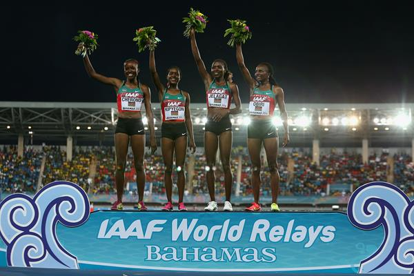 L-R) Mercy Cherono, Faith Chepngetich Kipyegon, Irene Jelagat and Hellen Onsando Obiri of Kenya celebrate on the podium after setting a new world record of 16:33.58 and winning the Women's 4x1500 metres relay  (Getty Images)