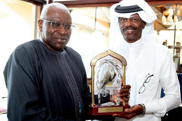 IAAF president Lamine Diack presents Talal Mansour with a commemorative crystal trophy (Laurel)