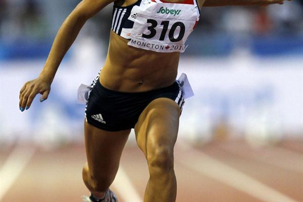 Jodie Williams, the youngest in the field, dips for the line, extending her winning streak to 149 races (Getty Images)