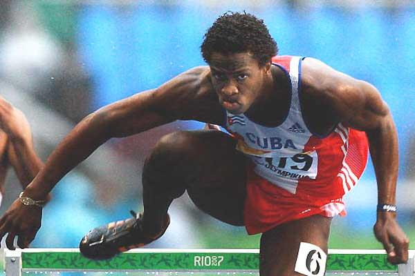 Dayron Robles of Cuba storms the 110m Hurdles gold in wet conditions in Rio (AFP / Getty Images)