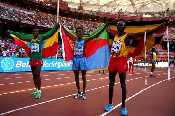 Marathon medallists Ghirmay Ghebreslassie (centre), Yemane Tsegay (left) and Solomon Mutai (right) at the IAAF World Championships, Beijing 2015 (Getty Images)