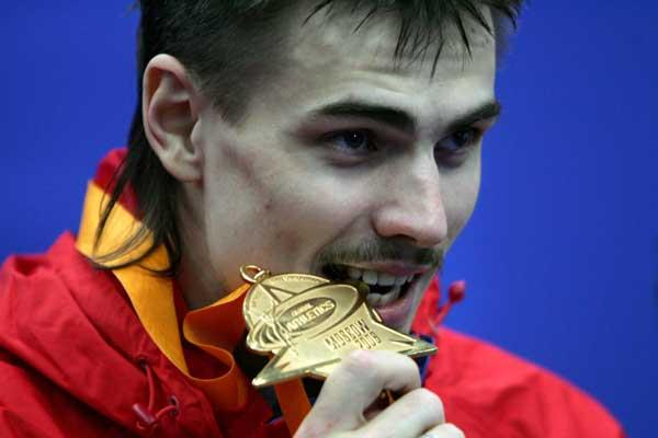 Yaroslav Rybakov of Russia bites his gold medal after winning the High Jump final (Getty Images)