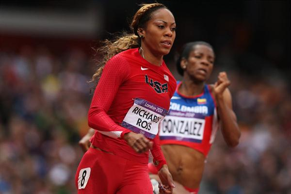 Sanya Richards-Ross of the United States runs alongside Norma Gonzalez of Colombia in the Women's 200m heat on Day 10 of the London 2012 Olympic Games on 6 August 2012 (Getty Images)