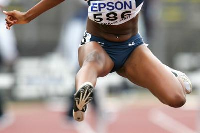 Dalilah Muhammad of USA during the 400m Hurdles heat (Getty Images)