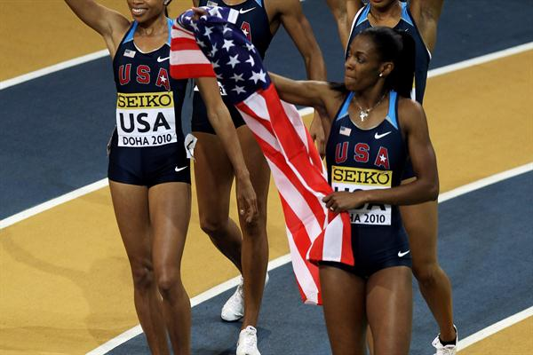 Debbie Dunn, Deedee Trotter, Natasha Hastings and Allyson Felix of USA make their victory celebrations after the womne's 4x400m Relay in Doha (Getty Images)