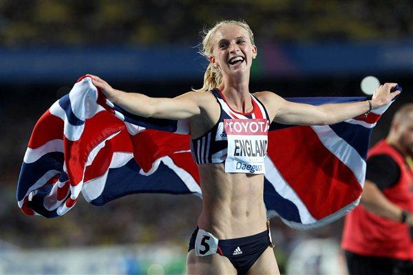 Hannah England of Great Britain celebrates with her country's flag after claiming silver in the women's 1500 metres final  (Getty Images)