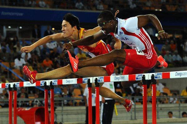 Liu Xiang and Dayron Robles neck and neck in the 110m Hurdles final (Getty Images)
