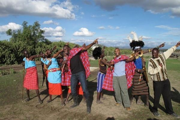 Spreading the word - honourary Maasi warrior Usain Bolt in central Kenya (Elias Makori)