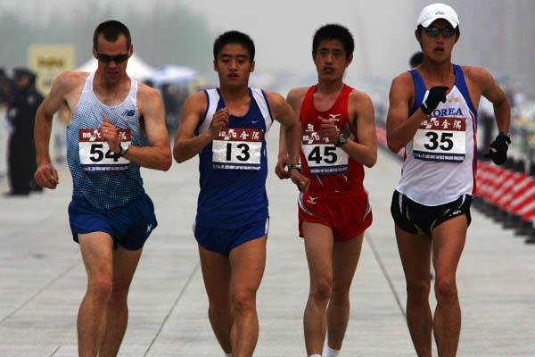 Tony Sargisson (NZL), Gao Lianzuo (CHN), Zhang Jiawei (CHN) and Yim Junghyun (KOR) in action in the 50km Race Walk in Beijing (Getty Images)