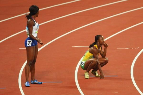 Veronica Campbell and Emma Ania look on as the batons fail to reach them (Getty Images)