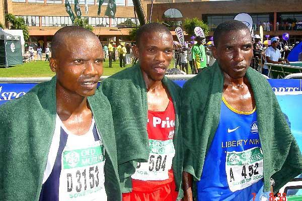 2004 Soweto Marathon - Left: Jumani Boki (Tan), 3rd; Middle: Mabuthile Lebopo (Lesotho), 1st; Right - Elijah Mutandiro(Zim), second. (Ouma)