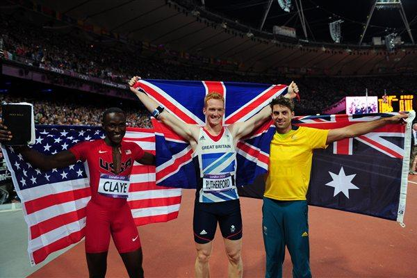 (L-R) Bronze medalist Will Claye of the United States, gold medalist Greg Rutherford of Great Britain and silver medalist Mitchell Watt of Australia celebrate after the Men's Long Jump Final on Day 8 of the London 2012 Olympic Games at Olympic Stadium on August 4, 2012 (Getty Images)
