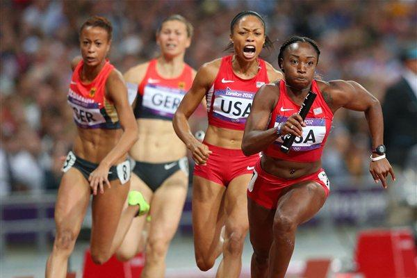 Bianca Knight of the United States receives he relay baton fom Allyson Felix of the United States on their way to winning gold in the Women's 4 x 100m Relay Final of the London Olympic Games on 10 August 2012 (Getty Images)