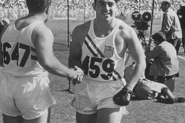 Harold Connolly (facing) is congratulated after his 1956 Olympic Hammer Throw victory in Melbourne, Australia (Time Life Pictures / Getty Images)