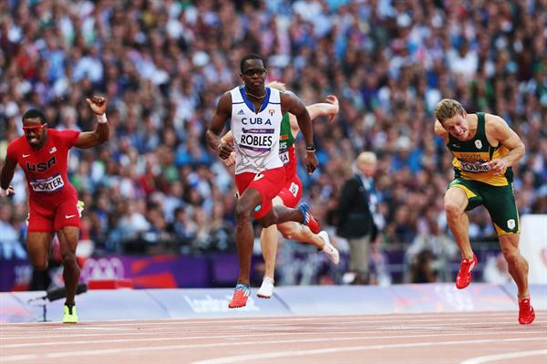 (L-R) Jeff Porter of the United States, Dayron Robles of Cuba and Lehann Fourie of South Africa compete in the Men's 110m Hurdles Semifinals on Day 12 of the London 2012 Olympic Games on 8 August 2012 (Getty Images)