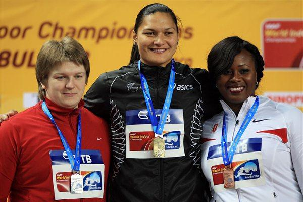(L-R) Silver medalist Nadzeya Ostapchuk of Belarus, gold medalist Valerie Adams of New Zealandand and Michelle Carter of the United States stand on the podium during the medal ceremony for the Women's Shot Put Final during day two - WIC Istanbul (Getty Images)