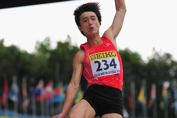 Qing Lin of China wins the boys' long jump final in Lille (Getty Images)
