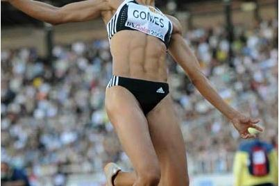 Naide Gomes of Portugal leaps 7.04m in Stockholm (Hasse Sjögren)