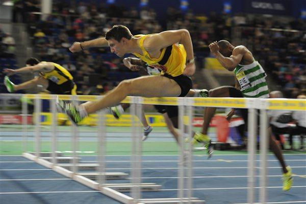 Andy Pozzi on the way to the UK indoor 60m Hurdles title in Sheffield (Getty Images)
