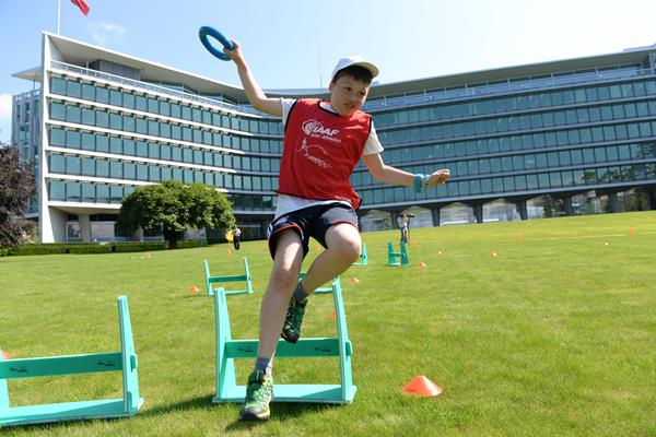 Children take part in the hurdles at the IAAF / Nestlé Kids' Athletics demonstration in Vevey, Switzerland (Jiro Mochizuki)