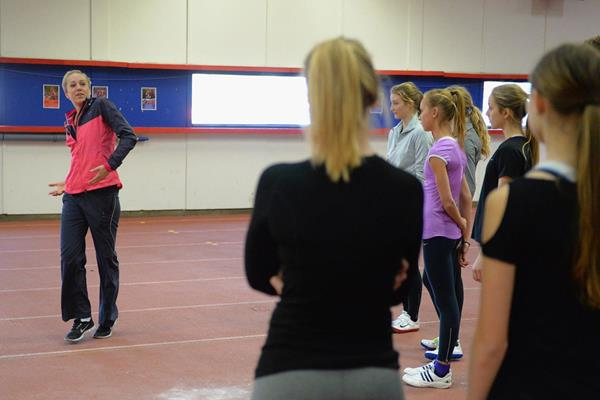 Kajsa Bergqvist coaches the high jump at the IAAF Ambassador Kids' Clinic in Copenhagen (Getty Images)