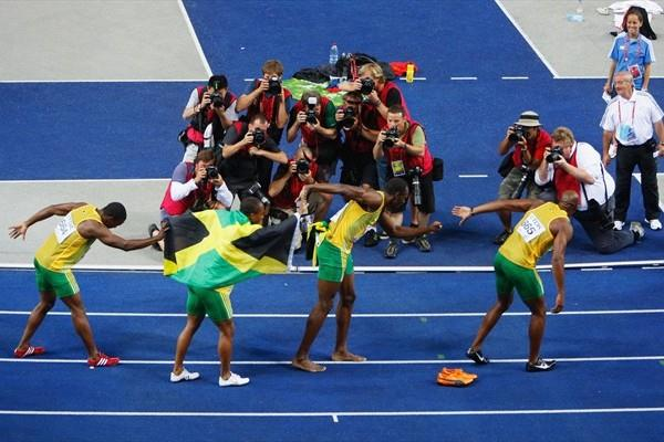 The Jamaican team re-enact their 4x100m gold medal winning performance in front of photographers in the Berlin Olympic Stadium at the 12th IAAF World Championships in Athletics (Getty Images)