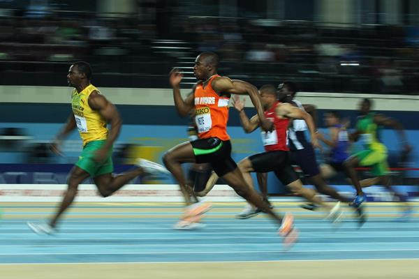 Nesta Carter of Jamaica and Ben Youssef Meite of Ivory Coast compete in the men's 60 Metres heats - WIC Istanbul (Getty Images)