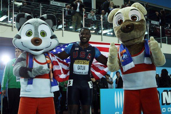 Justin Gatlin of the United States celebrates winning gold with mascots after the Men's 60 Metres Final during day two - WIC Istanbul (Getty Images)