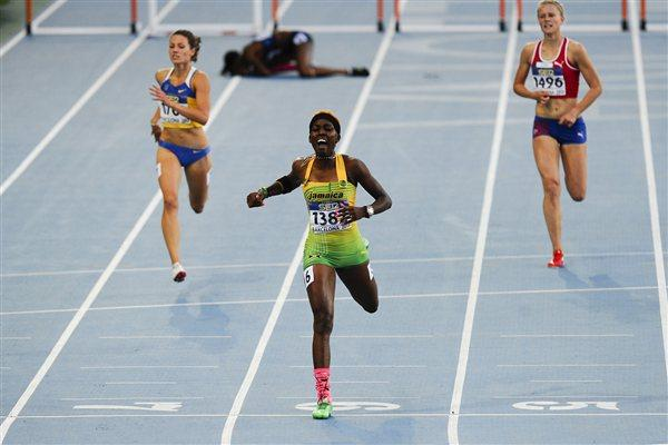 Janieve Russell of Jamaica (C) wins the Women's 400 metres Hurdles Final on the day five of the 14th IAAF World Junior Championships in Barcelona on 14 July 2012 (Getty Images)