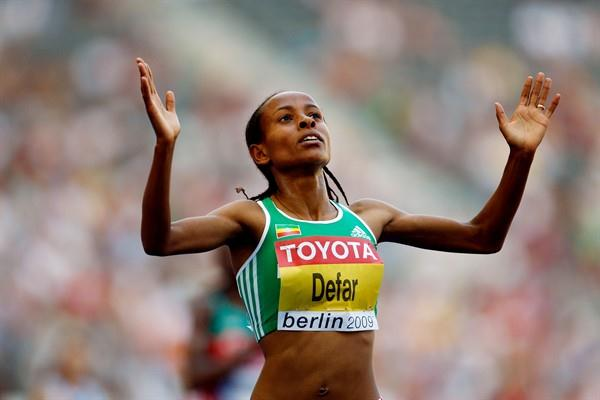 Defending Champion Meseret Defar of Ethiopia celebrates winning her heat of the women's 5000m in the Berlin Olympic Stadium (Getty Images)