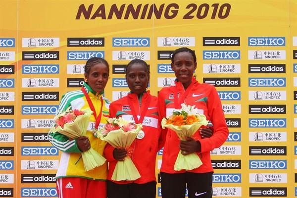The women's podium in Nanning - runner-up Dire Tune (ETH), champion Florence Kiplagat (KEN), and bronze medallist Peninah Arusei (KEN) (Getty Images)
