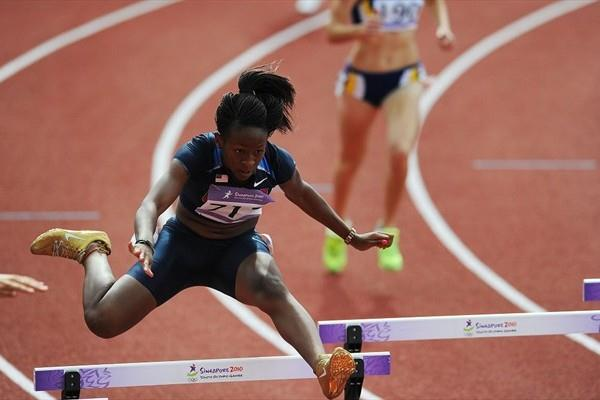 Amber Bryant-Brock of The United States in the Girls 400m Hurdles qualifying at the 2010 Youth Olympic Games in Singapore (XINHUA/ SYOGOC-Pool/ Liu Jie)