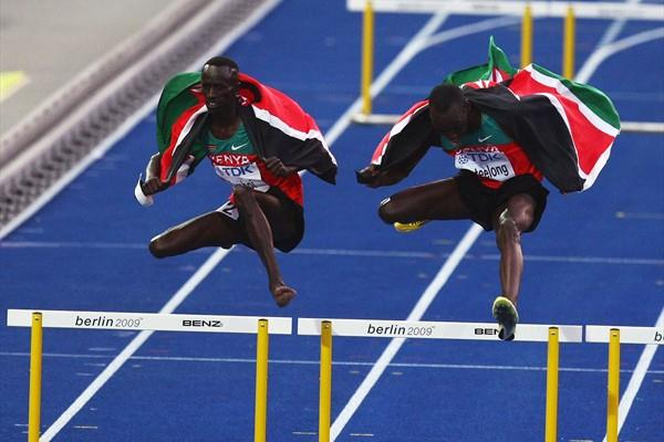 Ezekiel Kemboi of Kenya and Richard Kipkemboi Mateelong of Kenya celebrate their 3000m Steeplechase gold and silver medals by attempting some different barriers (Getty Images)
