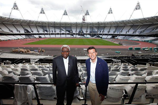 IAAF President Lamine Diack and LOCOG chairman Lord Sebastian Coe pose for photographs during a visit to the London 2012 Olympic stadium site in Stratford, on August 5, 2011 in London, England (Getty Images)