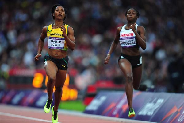 Shelly-Ann Fraser-Pryce of Jamaica runs alongside Crystal Emmanuel of Canada in the Women's 200m heat on Day 10 of the London 2012 Olympic Games on 6 August 2012 (Getty Images)