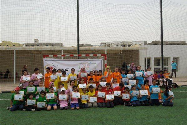 Participants with their certificates at a Kid's Athletics event in Cairo (IAAF)