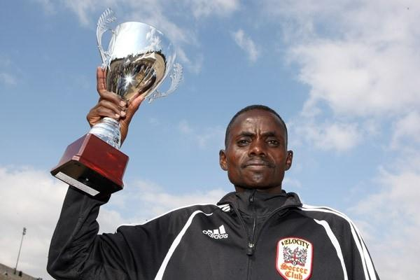 Paul Lekuraa with the winner's Cup for the 2008 Athens Marathon (Victah Sailer)