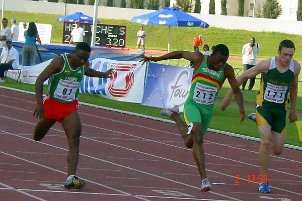 African Jnrs - Senegal's Katrim Toure (212) edging Ethiopia's  Gellecha Wetere (91) for the gold medal in 100m (Mark Ouma)