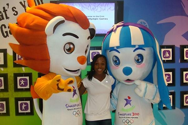 Jamaica's double Olympic 200m champion Veronica Campbell Brown sandwiched between the mascots for the Singapore Youth Olympics, taken while in Singapore (c)