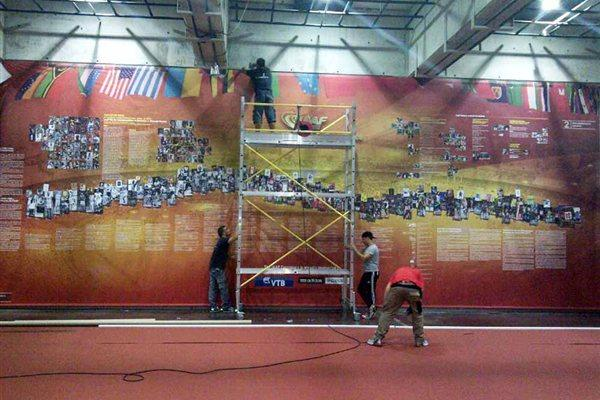 IAAF Centenary Historic Exhibition - one of the giant 4m high displays are erected (Chris Turner / IAAF)