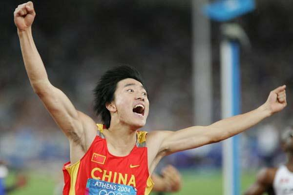 Liu Xiang equals the World record to take gold in the 110m Hurdles in Athens (Getty Images)