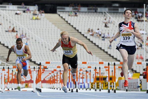 James Gladman (R) of Great Britain wins his Men's 110 metres Hurdles qualification heat on the day one of the 14th IAAF World Junior Championships in Barcelona (Getty Images)
