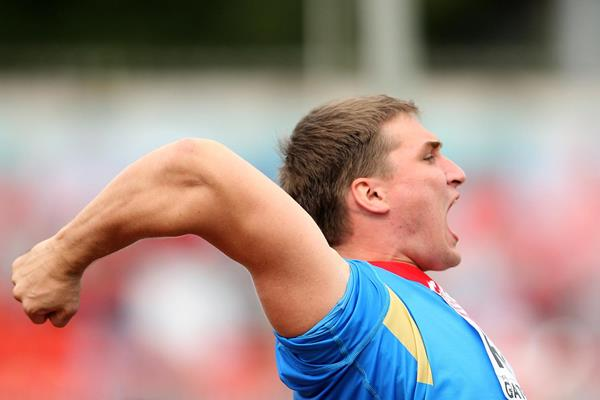 Russia's Dmitri Tarabin celebrates a good throw in the Javelin (Getty Images)