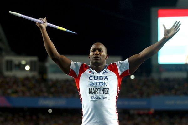 Guillermo Martinez of Cuba motivates the crowd during the men's javelin throw final (Getty Images)