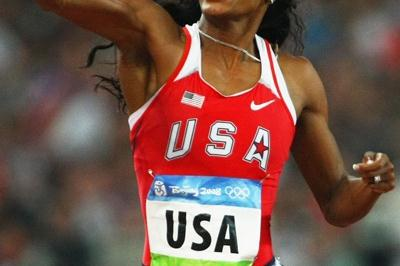 Sanya Richards punches the air as the crosses the line to win 4x400m gold (Getty Images)