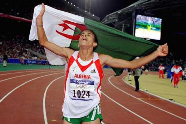 Nouria Merah- Benida celebrates with Algerian flag in Sydney (Getty Images)